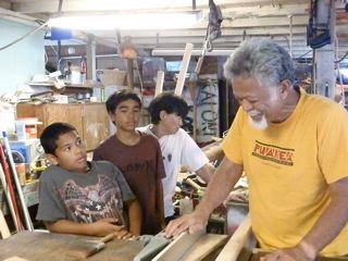 Uncle Bobby mentoring keiki as they learn about Hawaiian woodworking